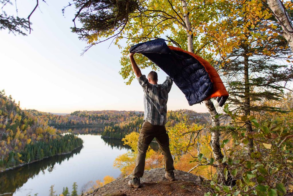 Standing over a lake near Finland, Minnesota, with my Enlightened Equipment quilt during a beautiful fall evening on the Superior Hiking Trail.