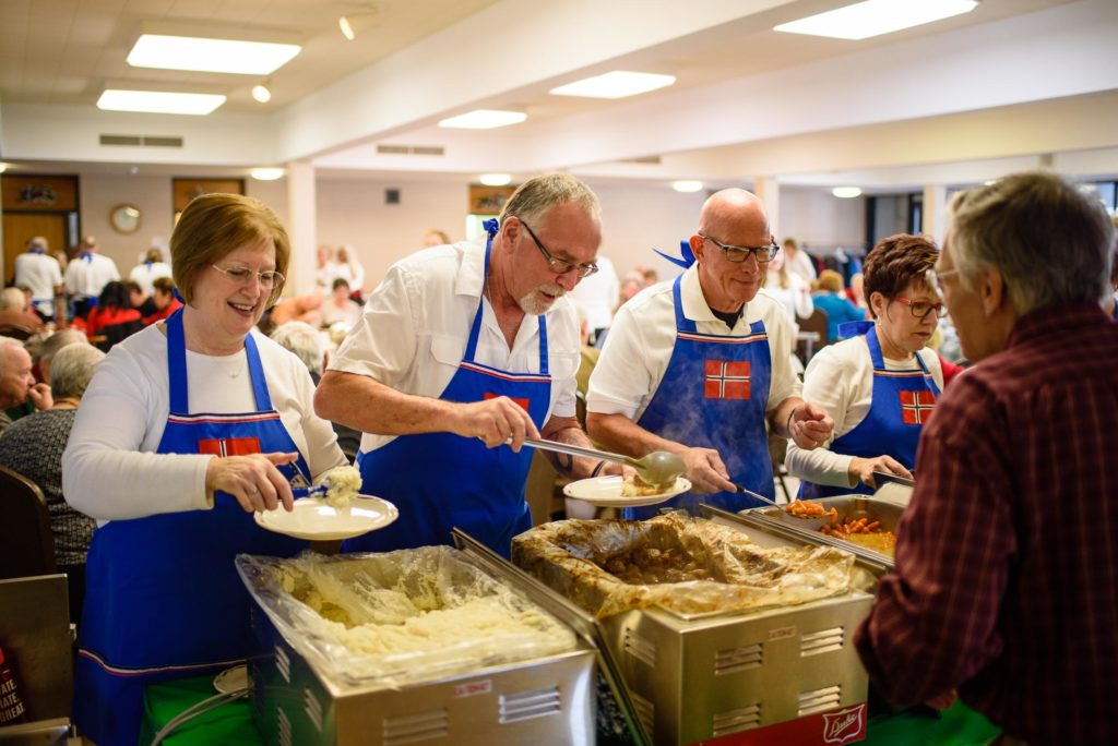 It takes a full team to serve lutefisk and it's accoutrements, potatoes, carrots and meatballs.