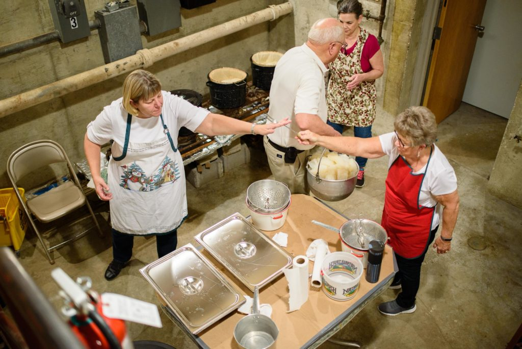 Lutefisk volunteers work together to feed hundreds of hungry Norwegian descended locals.