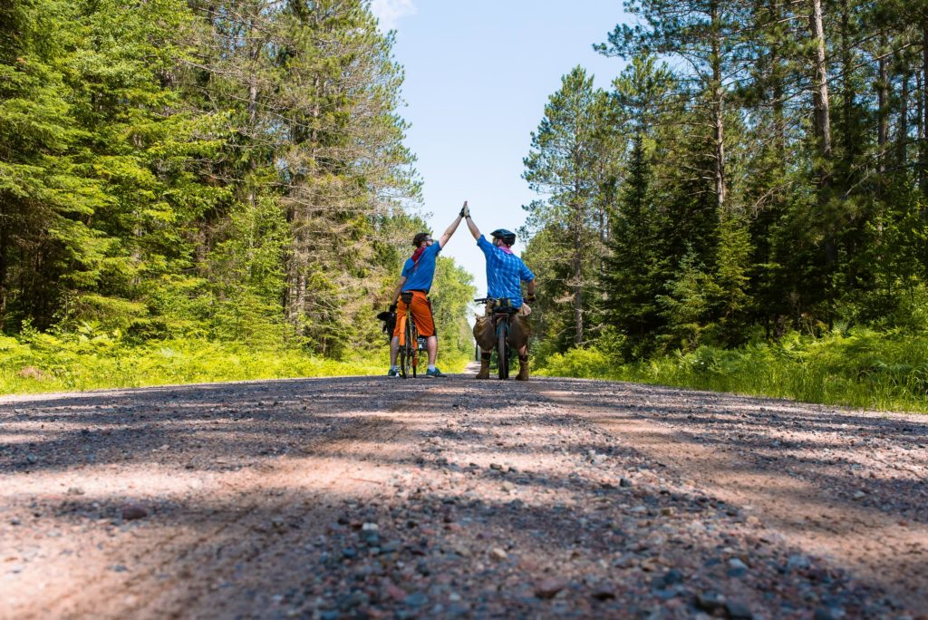 Chequamegon trail, boys biking with heavy bikes through the woods while killing mosquitos.