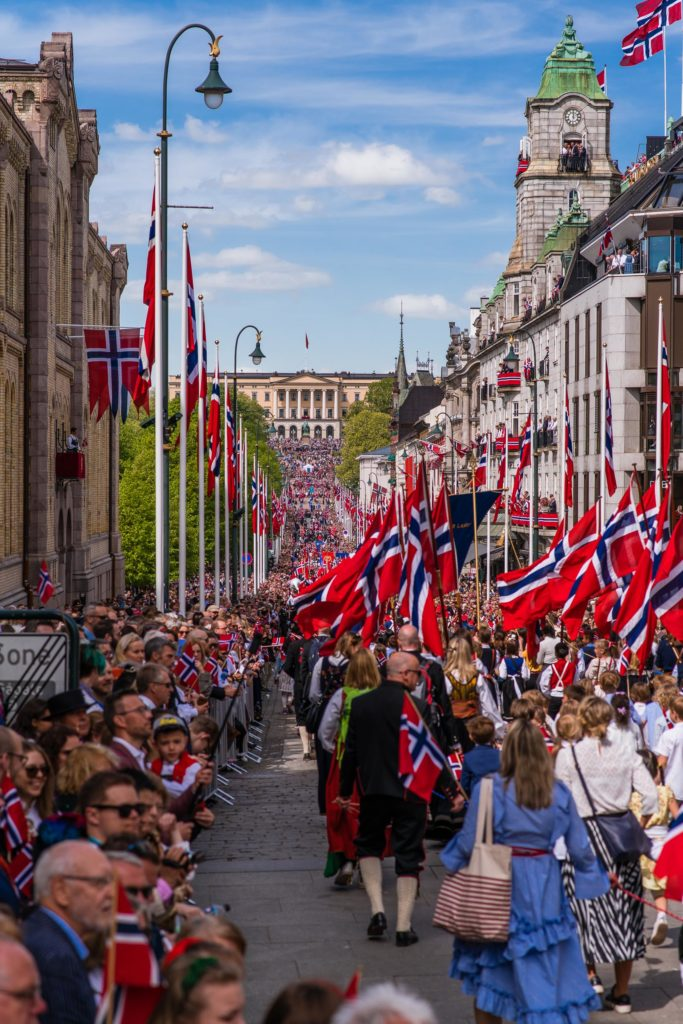 The Oslo castle capital looms in the background on Syttende Mai, Constitution Day of Norway.