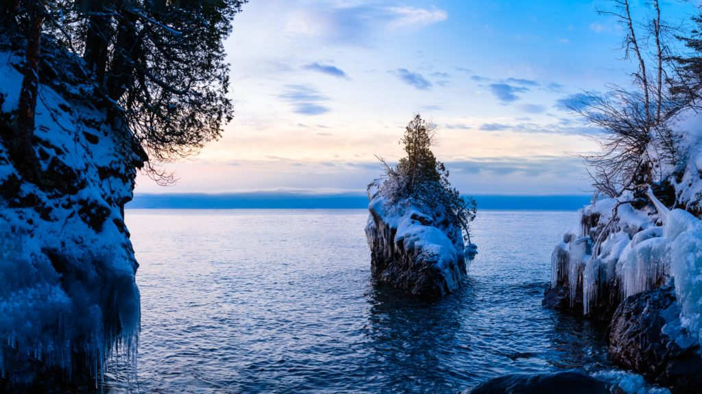 A rock stands alone on Lake Superior in a hidden cove at Tettegouche State Park, waiting for sunrise to warm it up.