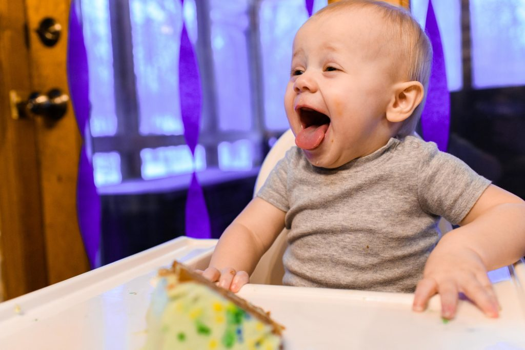 My nephew on his one year old birthday party trying cake for the first time.
