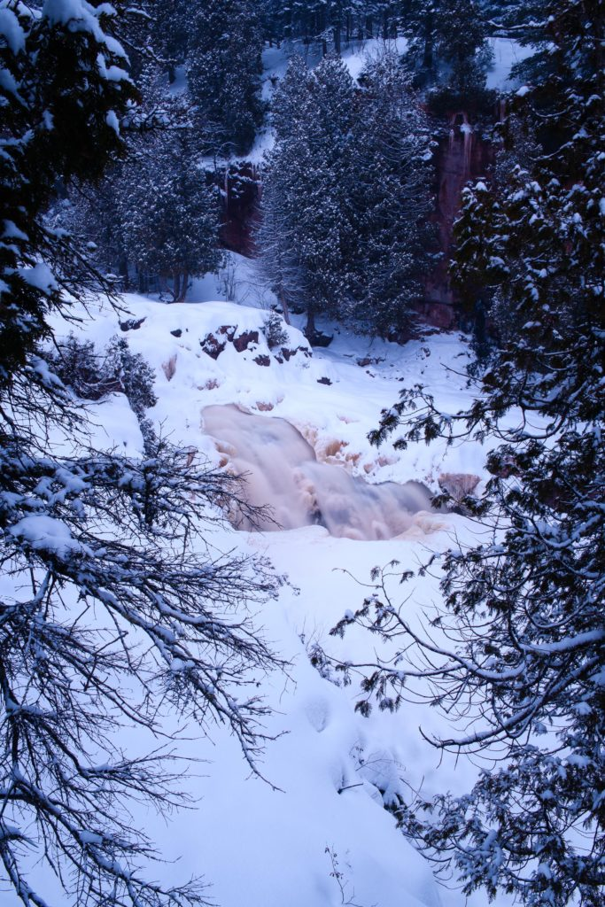 Part of the frozen waterfalls in Gooseberry Falls State Park just before darkness sets completely.