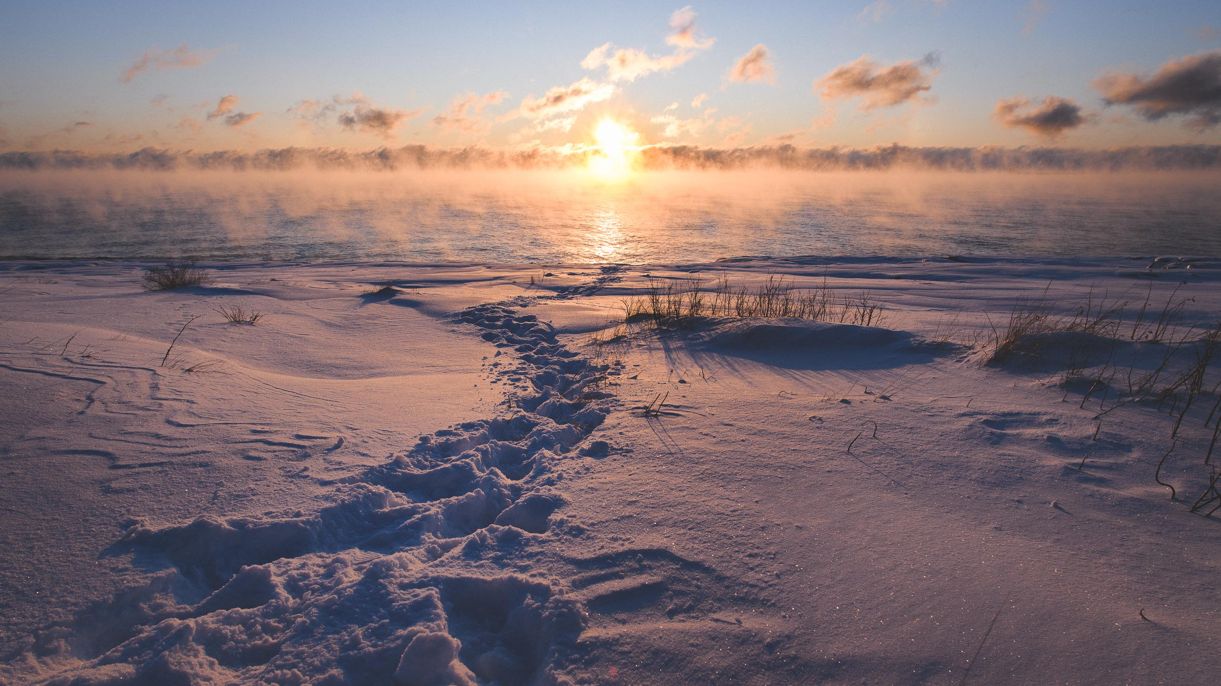 Footsteps lead to water's edge on Lake Superior for a sunrise at Gooseberry Falls State Park on Lake Superior in Minnesota.