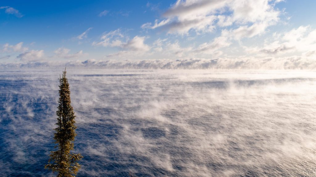 Sea smoke dances over the top of Lake Superior as the day begins to warm up.